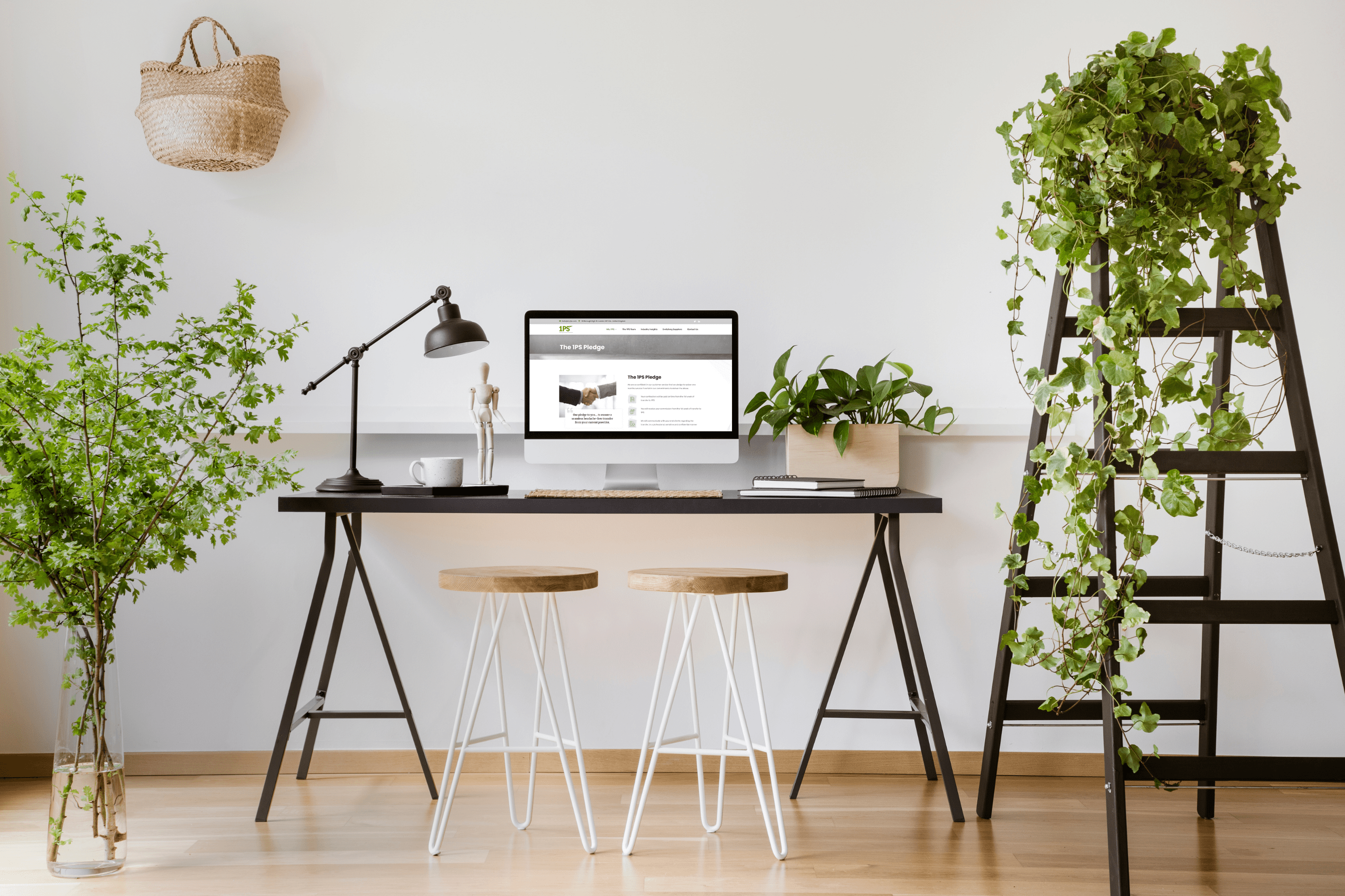 Laptop on table surrounded by plants